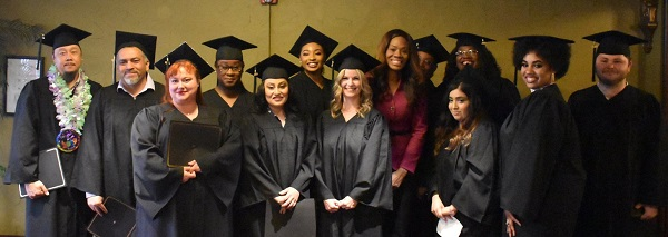 graduates with council member